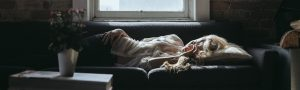 Tired woman sleeping on sofa