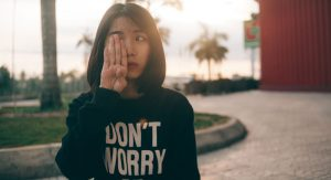 Lady wearing don't worry jumper