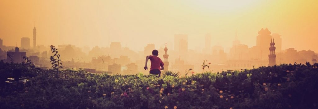 Person running against city landscape