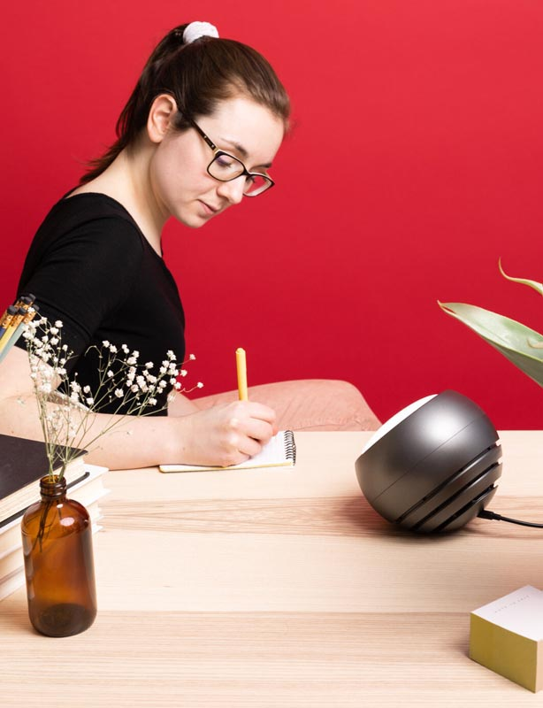 Person at desk with SAD lamp