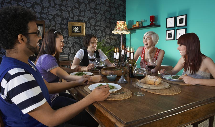 Group of people sitting at dining table
