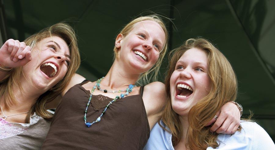 Three females looking happy
