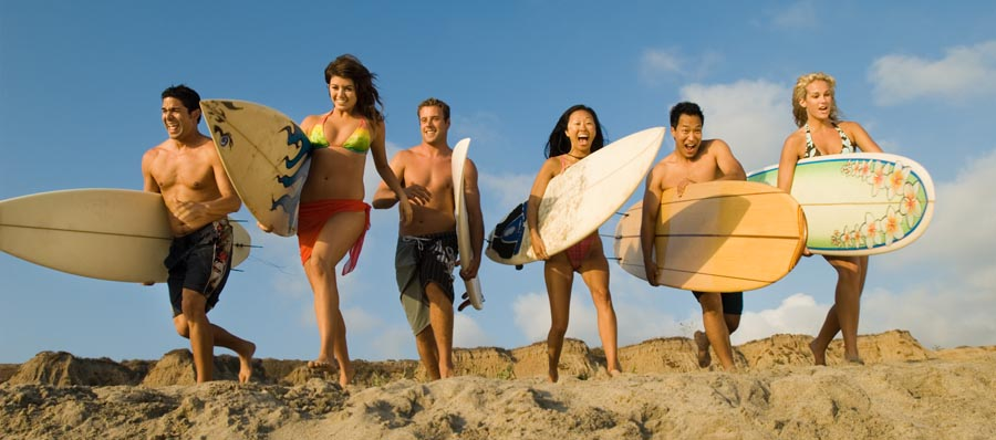 Six people with surfboards on beach