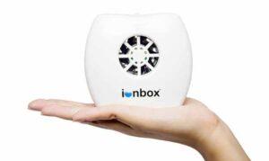 IonPacific IonBox negative ion generator in hand