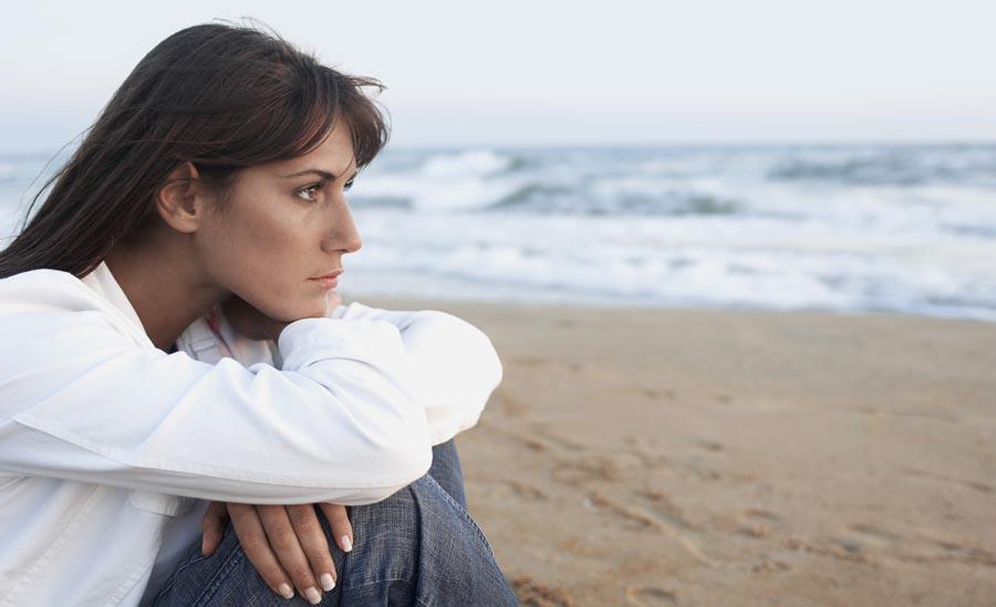 Sad lady on beach