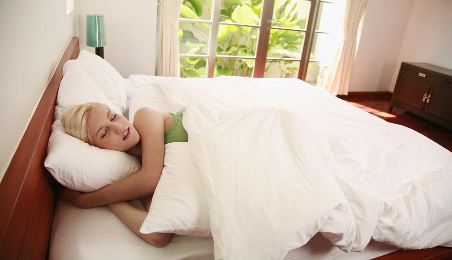 Person lying in bed on nice day