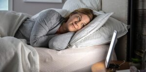 Verilux HappyLight Lumi with person sleeping in front of it